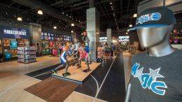 Interior of NBA Store inside NBA Experience at Disney Springs - close up of Orlando Magic hat and t-shirt