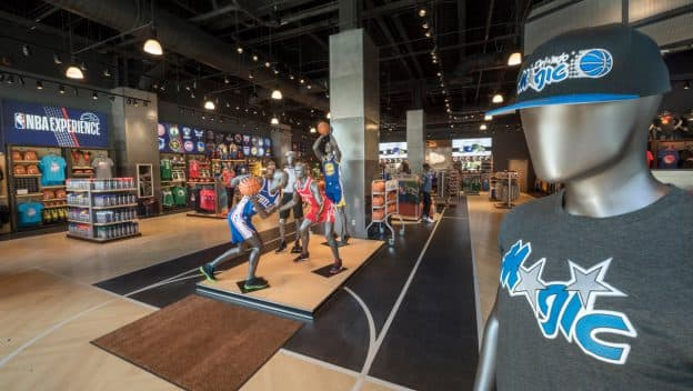 Interior of NBA Store inside NBA Experience at Disney Springs - close up of Orlando Magic hat and t-shirt