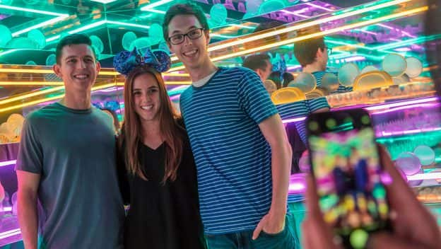 Guests pose for a photo inside Pop-Up Disney! A Mickey Celebration in Downtown Disney District
