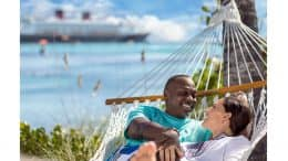 Couple lays in a hammock at Castaway Cay