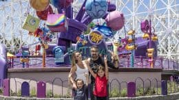 Actor Jaime Camil poses for a picture with his wife and children in front of Inside Out Emotional Whirlwind, Pixar Pier's newest attraction, at Disney California Adventure Park - Disneyland Resort