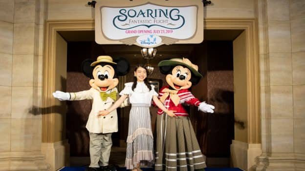 Japanese professional figure skater Rika Kihira with Mickey Mouse and Minnie Mouse at Soaring: Fantastic Flight at Tokyo DisneySea
