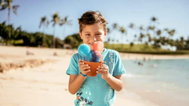 Child eating shaved ice at Aulani, a Disney Resort & Spa in Hawaii