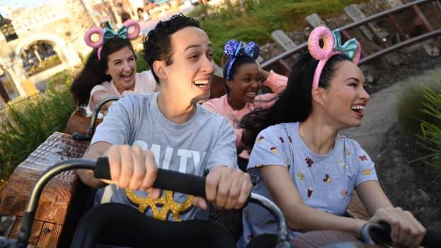 Guests ride Seven Dwarfs Mine Train at Magic Kingdom Park