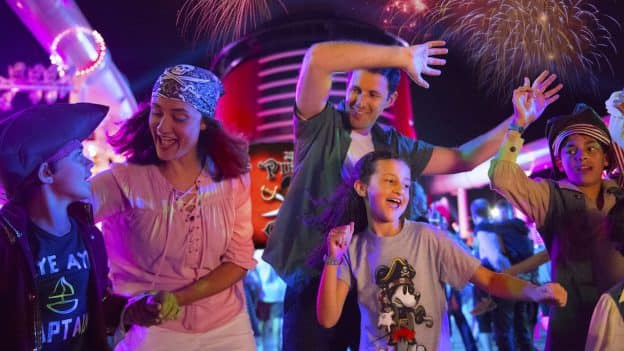 Family dancing at a deck party on Disney Cruise Line ship