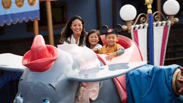 Family rides Dumbo at Disneyland park