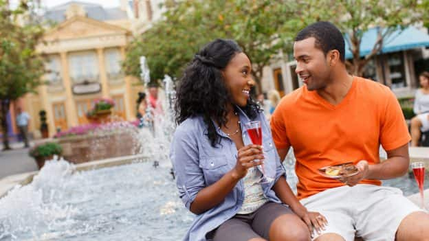 Couple enjoying Epcot International Food & Wine Festival