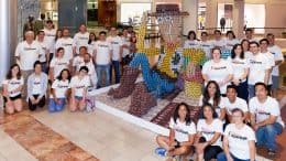 Disneyland Resort Design & Engineering team and Woody made out of cans