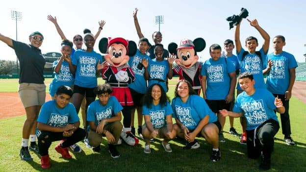 Orlando After-School All-Stars pose with Mickey Mouse and Minnie Mouse at ESPN Wide World of Sports Complex