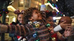 "Family celebrates in the ""Snow"" on Main Street U.S.A. at Magic Kingdom Park"