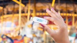 Disney PhotoPass Archive USB product in front of Prince Charming Regal Carrousel