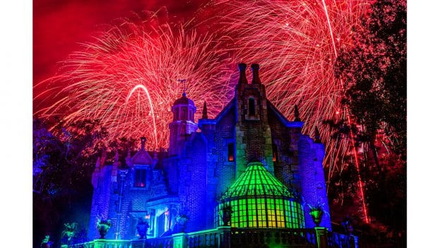 """Disney's Not-So-Spooky Spectacular"" fireworks, as seen from the exterior of the Haunted Mansion at Magic Kingdom Park"