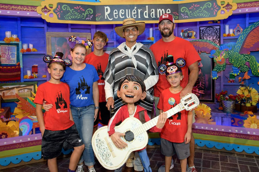 "Actress Melissa Joan Hart, her husband Mark Wilkerson, and their kids, Mason, Braydon, and Tucker, meet Miguel of Disney and Pixar's film ""Coco"" at Disney California Adventure Park"