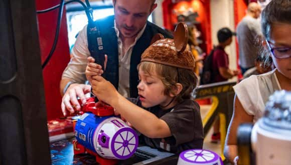 Young boy builds a droid at