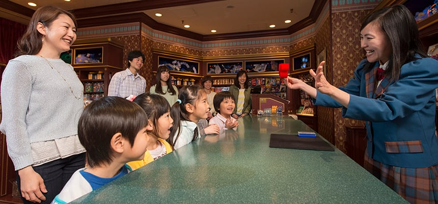 hollywood Demonstrations and illusions always draw an appreciative audience in the Magic Shop at Tokyo Disneyland. © Disney