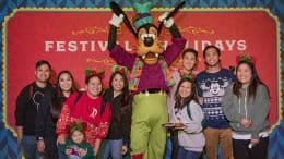 Disney Parks Blog Readers pose with Goofy at the Holiday 2019 Meet-Up at Disney California Adventure Park