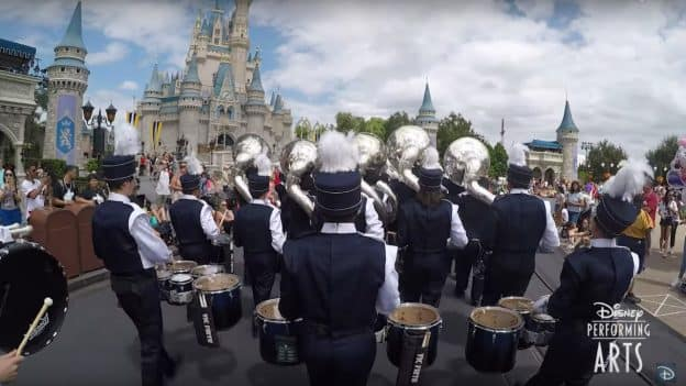 Marching Band marches in front of Cinderella Castle at Magic Kingdom Park as with Disney Performing Arts