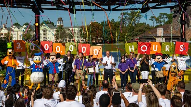"""The Walt Disney Company and Points of Light honored the """"Volunteer Family of the Year"""" at Disney Springs at Walt Disney World Resort, Nov. 23, 2019, in Lake Buena Vista, Fla. During an inspiring ceremony, thousands of guests and Disney Cast Members celebrated the Aguirre family of McAllen, Texas (purple shirts), along with Disney Parks, Experiences and Products Chairman Bob Chapek (center), Walt Disney World Resort President Josh D'Amaro (right of Mickey Mouse), Points of Light CEO Natalye Paquin (left of Minnie Mouse), and Disney characters."""