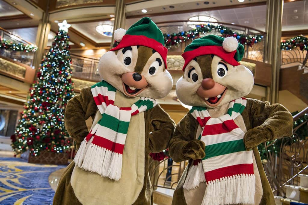 """In the spirit of holiday cheer, Disney Cruise Line adds sparkle to each ship during Very Merrytime Cruises, with Disney characters dressed in festive attire, special stem-to-stern holiday events, traditional """"turkey day"""" fanfare, Christmas feasts, """"snow flurries"""" and New Year's Eve galas"""