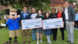 The Aguirre family from McAllen, TX with Mickey Mouse, Stephen Lim (WDW ambassador), Points of Light CEO Natalye Paquin, and GMA's Will Reeve