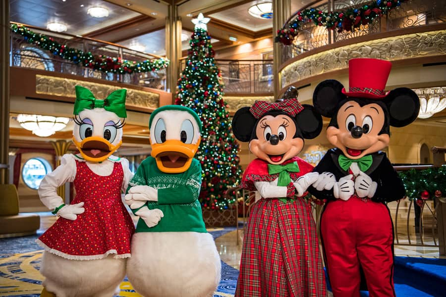 Donald and Daisy and Mickey and Minnie in holiday attire aboard Disney Cruise Line