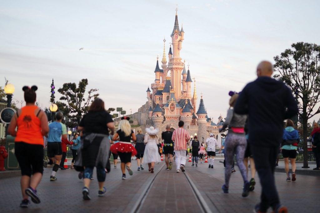 Guests running at Disneyland Paris