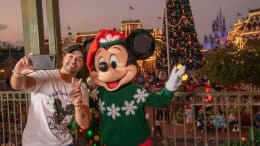 Luis Fonsi poses with Mickey Mouse during Mickey's Very Merry Christmas Party at Magic Kingdom Park