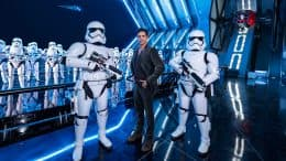 John Stamos and Stormtroppers in Star Wars: Rise of the Resistance