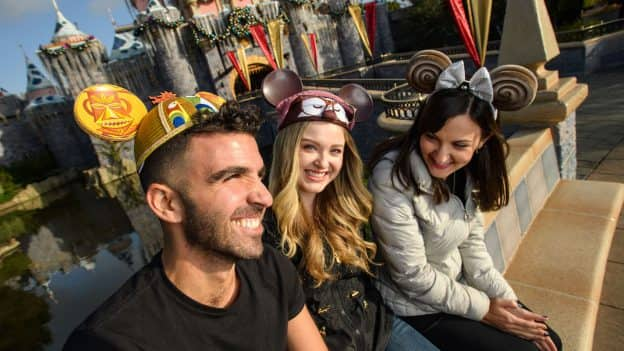 Guests wearing Minnie Mouse ear headbands and Mickey Mouse ear hats at Disneyland Resort