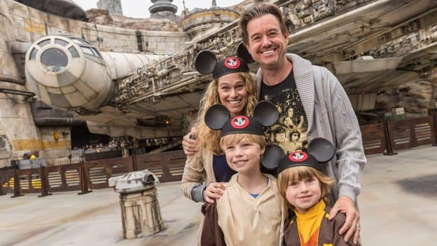 Family poses for photo in Star Wars: Galaxy's Edge