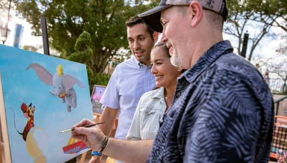 Artist paints at the Epcot International Festival of the Arts