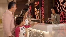 Family checking in to a Walt Disney World Resort Hotel