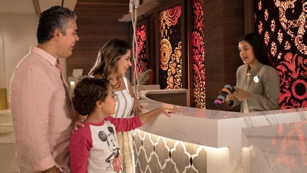 Family checking in to a Walt Disney World Resort Hotel