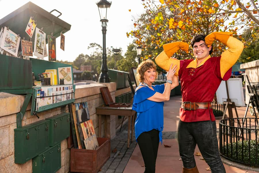 Paige O'Hara poses with Gaston at Epcot