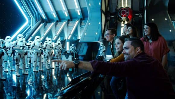 Parker Anderson and his family inside Star Wars: Rise of the Resistance