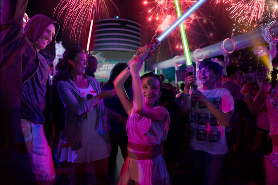"Little girl dresses as Rey and her family at the ""Summon the Force"" deck party during Star Wars Day at Sea"