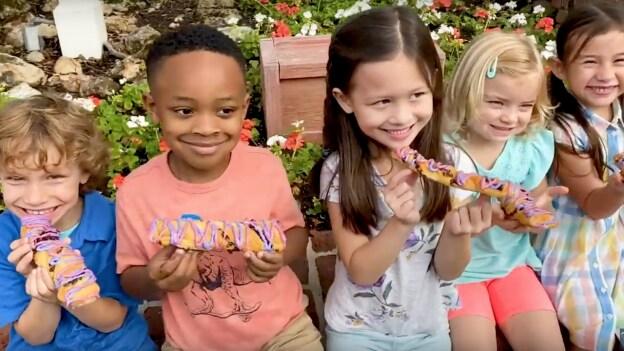 Disney Kids eating treats at Magic Kingdom Park