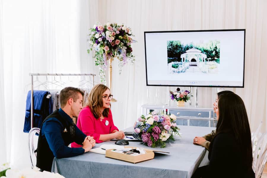 Couple meeting with Disney Weddings team
