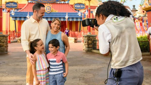 Family using Disney Photopass in Magic Kingdom Park