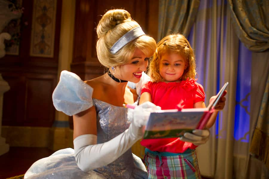 Girl meeting Cinderella at Princess Fairytale Hall