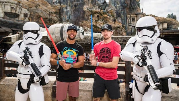 NASCAR Cup Series Drivers Ryan Blaney and Bubba Wallace with Stormtroopers in Star Wars: Galaxy's Edge