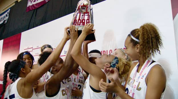 Girls basketball team celebrating