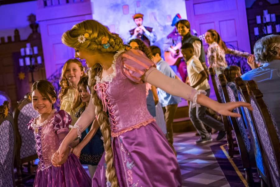 Rapunzel dances with guests in Rapunzel's Royal Table aboard the Disney Magic
