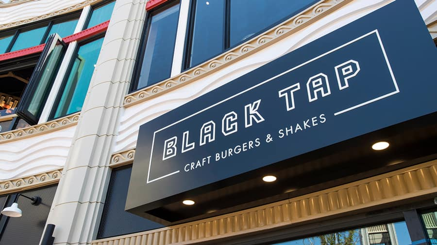 Welcome Back to Downtown Disney District, Phased Reopening Begins Today at Disneyland Resort Black Tap Craft Burgers & Shakes exterior - Earl of Sandwich exterior -Downtown Disney District at Disneyland Resort