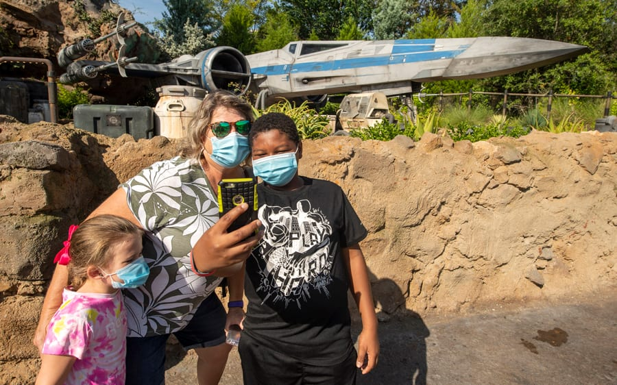 Guests take a selfie in Star Wars: Galaxy's Edge at Disney's Hollywood Studios