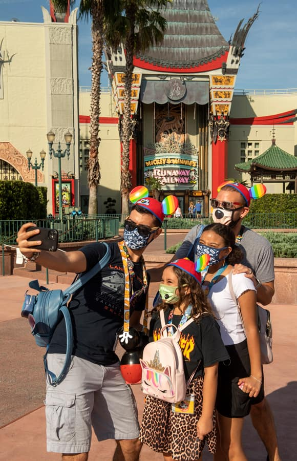 Guests take a selfie in front of Mickey and Minnie's Runaway Railway