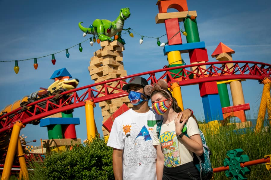 Guests pose in front of Slinky Dog Dash in Toy Story Land at Disney's Hollywood Studios