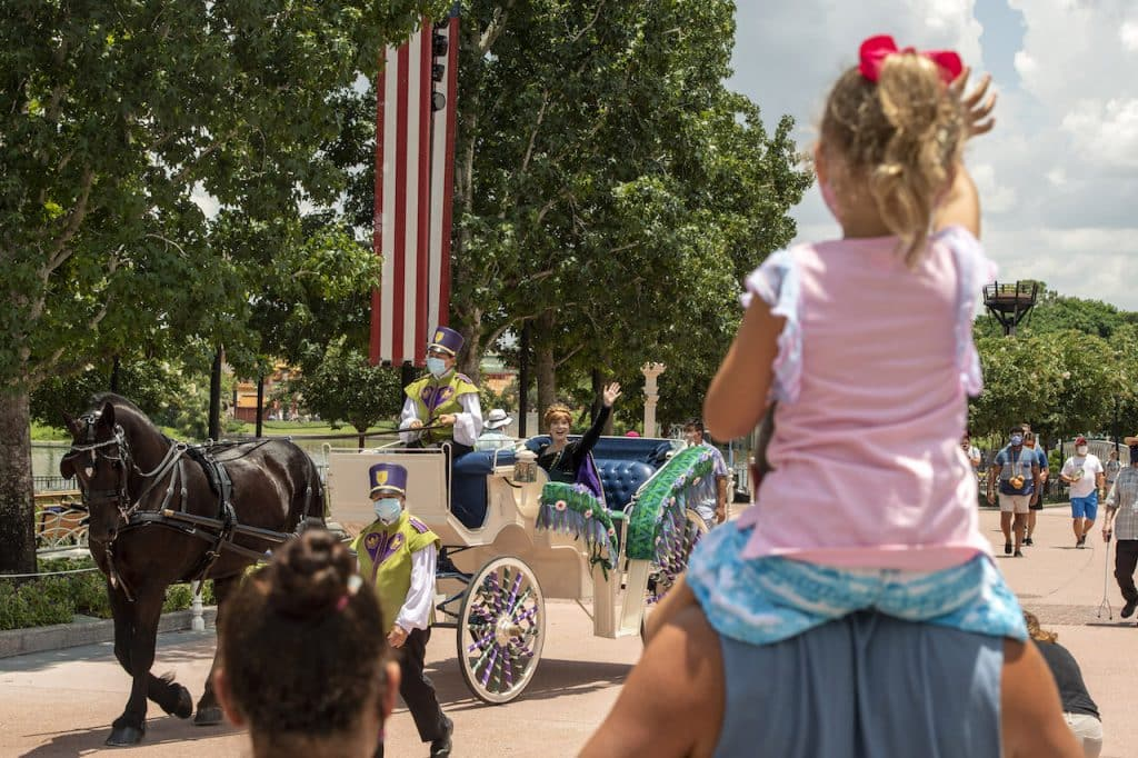 Little girl waving to Anna at EPCOT
