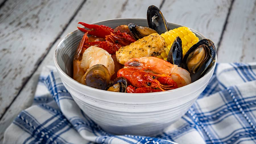 Offerings from Hops & Barley Marketplace for the 2020 Epcot Taste of International Food & Wine Festival - Southern Seafood Boil: Shrimp, Mussels, Crawfish, Potatoes, Corn, and Andouille Sausage