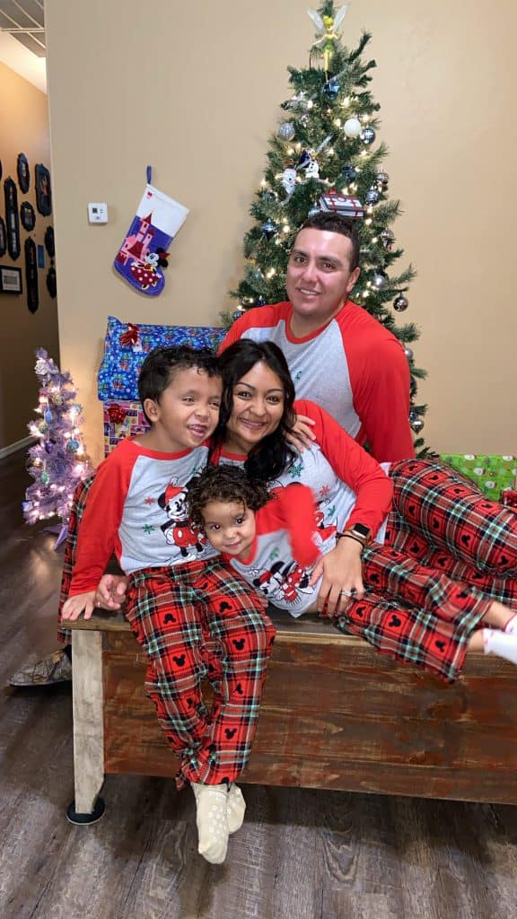 Family in matching Disney Christmas pajamas